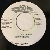 DENNIS BROWN / SITTING & WATCHING - REVOLUTION