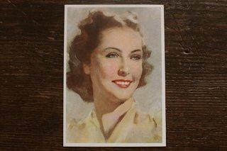 古いポストカード(黄色のブラウスの女性)