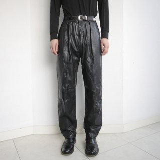 old tuck tapered leather trousers
