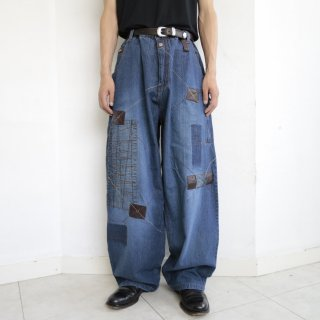 old leather combi repaired buggy jeans