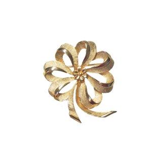 トリファリ・可憐な金色リボンのブローチ