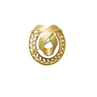 トリファリ・透かし模様の金色リボンのブローチ