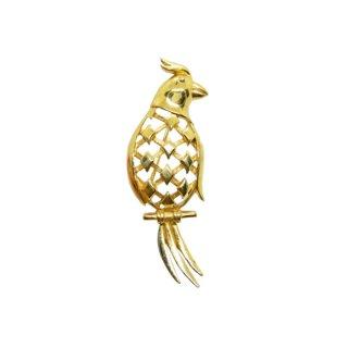 トリファリ・金色の鸚鵡のブローチ