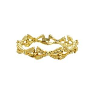 トリファリ・チャーミングな金色リボンのブレスレット